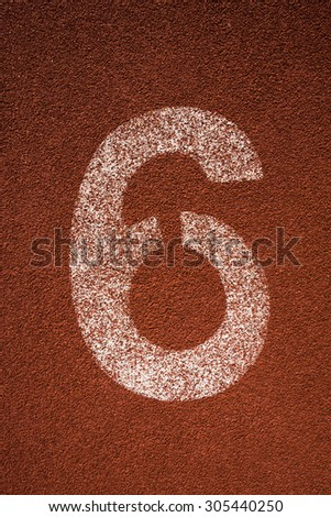 Red running track lane number 6 - stock photo