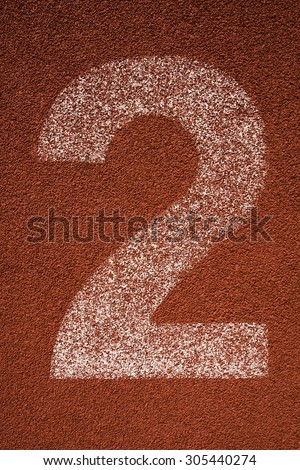 Red running track lane number 2 - stock photo
