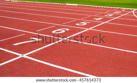 Red running track on the athletic stadium.