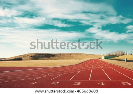 red running track with blue sky vintage - stock photo