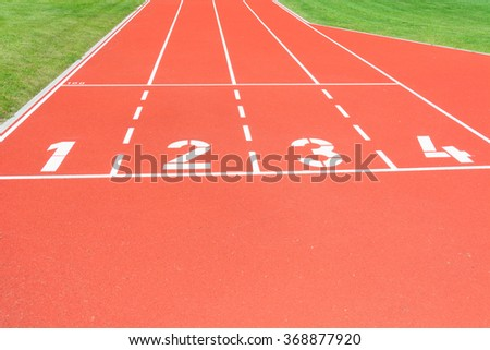 Red running track with the start numbers. - stock photo
