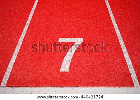 Red running tracks white number seven in stadium for competition or business concept