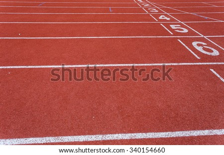 Red running tracks with green - stock photo
