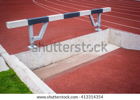 red running tracks with hurdle. - stock photo
