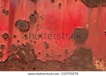 red rusty painted metal background