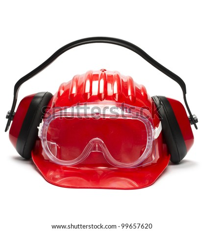 Red safety helmet with earphones and goggles. - stock photo