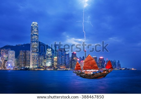 Red sailboat flag and thunderstorm in Hong Kong harbor - stock photo