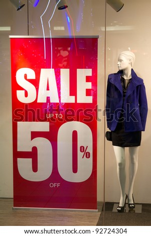 Red sale banner outside of fashion shop - stock photo