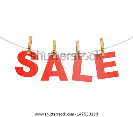 red sale letters hanging on rope with clothespin