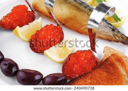 red salmon caviar with smoked fish and toast - stock photo