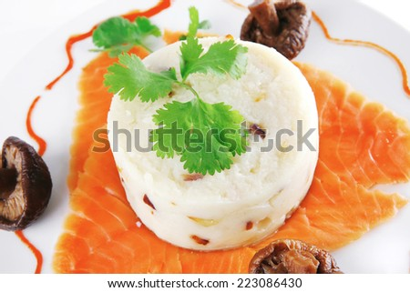 red salmon with mash served on ceramic plate - stock photo