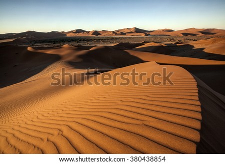 Red sand dunes in a desert - stock photo
