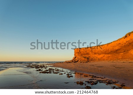 Red Sandstone Cliffs (Green Gables Shore, Prince Edward Island , Canada) - stock photo