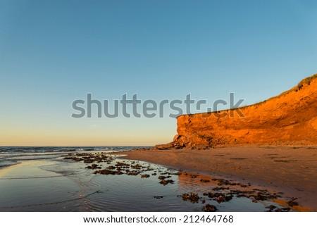 Red Sandstone Cliffs (Green Gables Shore, Prince Edward Island , Canada) - stock photo