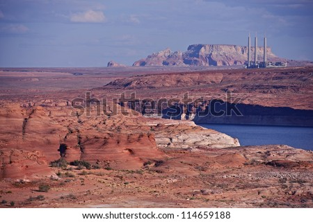 Red Sandstones and Lake Powell in Page, Arizona. Navajo Generating Station in a Distance. Arizona Photography Collection. - stock photo