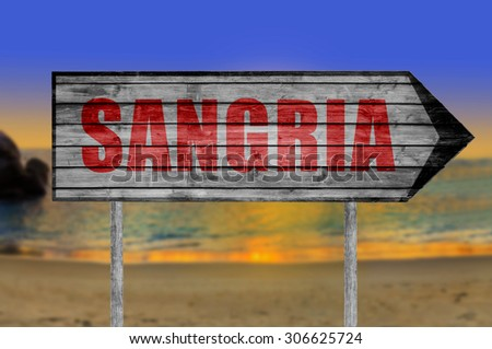 Red Sangria wooden sign with on a beach background - stock photo