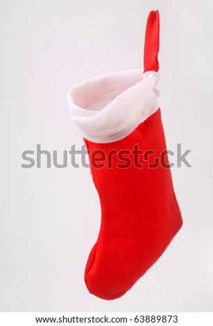 Red santa claus stocking on a grey background - stock photo