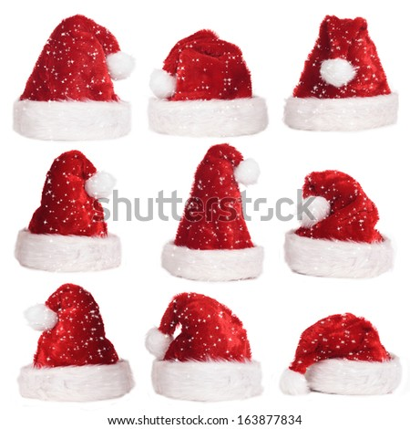 Red Santa hats with snow flakes - stock photo