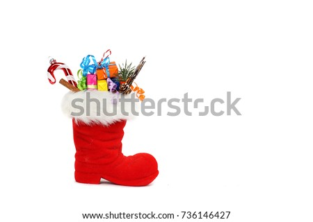 Red Santa's boot with copy space isolated on white background