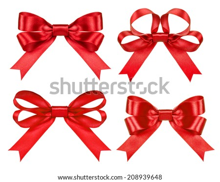 red satin bows on the isolated white background - stock photo