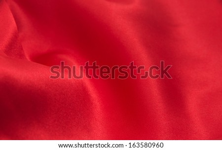 red satin or silk fabric as background - stock photo