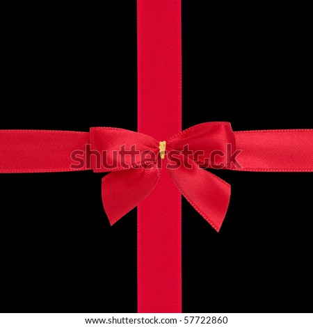Red satin ribbon and bow gift box wrapping  isolated over black background. - stock photo