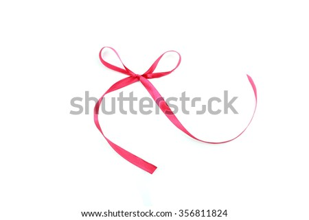 Red satin ribbon with bow on white background