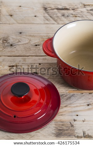 Red saucepan with its lid - stock photo
