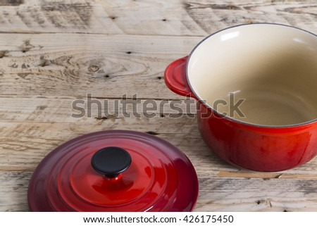 Red saucepan with lid off - stock photo