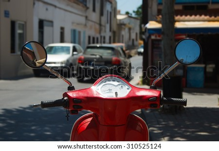 red scooter wheel view of the street and the cars blur - stock photo