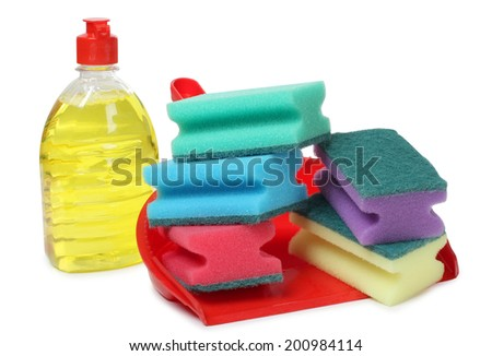 Red scrub and cleaning products on white background - stock photo