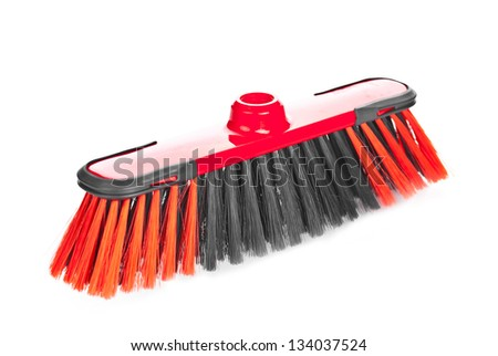 Red scrubbing broom on white background - stock photo