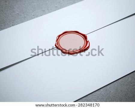 Red seal wax on white envelope - stock photo
