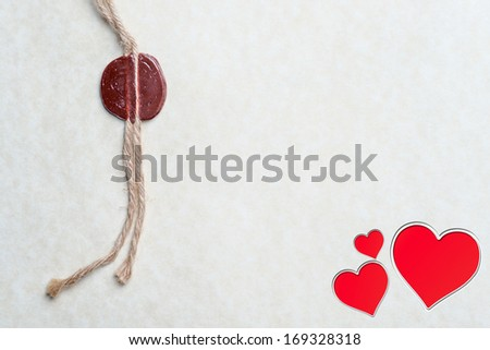 Red sealing wax stamp on vintage envelope with heart  - stock photo