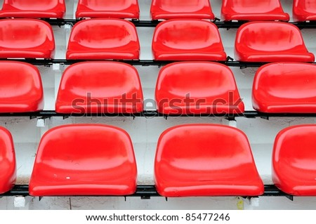Red seat at Thep Hasadin Stadium in Bangkok, Thailand - stock photo