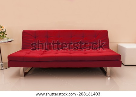 red seat decorated in pink room