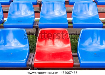 Red seat in blue seats on the stadium
