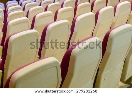 red seat in small theater in house - stock photo