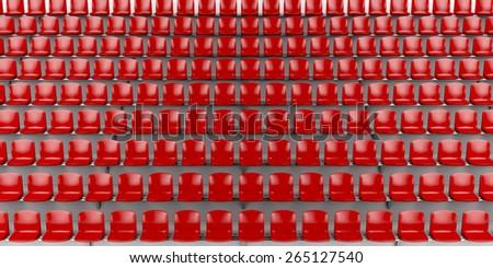 Red seats at the football stadium - stock photo