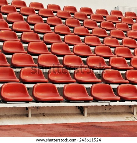 Red Seats in a Stadium - stock photo