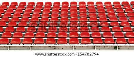 Red seats in stadium. - stock photo