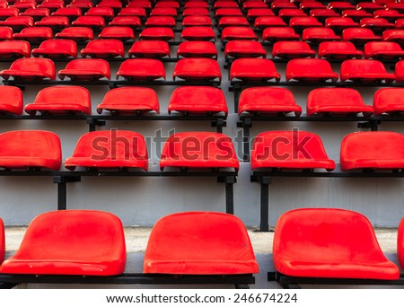 red seats in stadium - stock photo