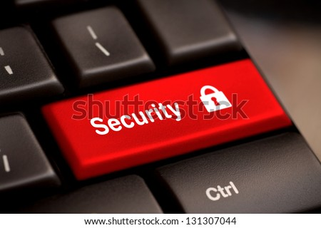 Red security button on the keyboard - stock photo