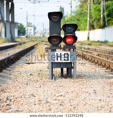 Red semaphore on railway - stock photo