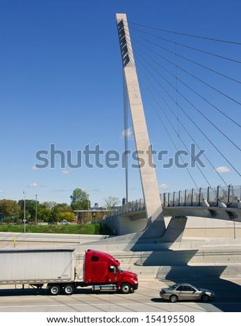 Red Semi Truck on Detroit area freeway - stock photo