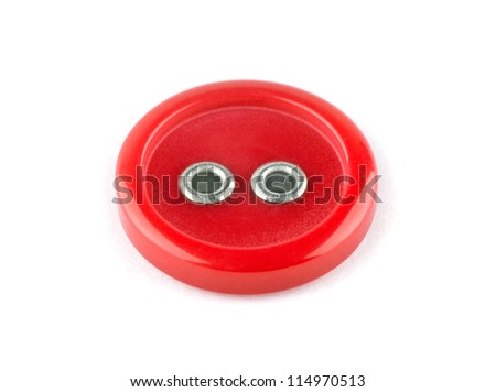 Red sewing button on white background