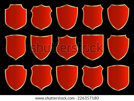 red shields with golden border; set with various shapes  - stock photo