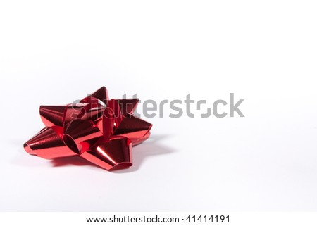Red Shiny Gift Bow isolated against white background from low viewpoint.