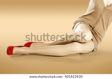 red shoes and slim long legs and brown clothes  - stock photo