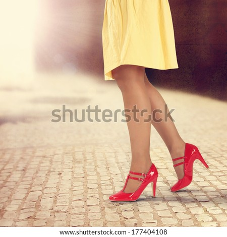 red shoes and yellow skirt  - stock photo
